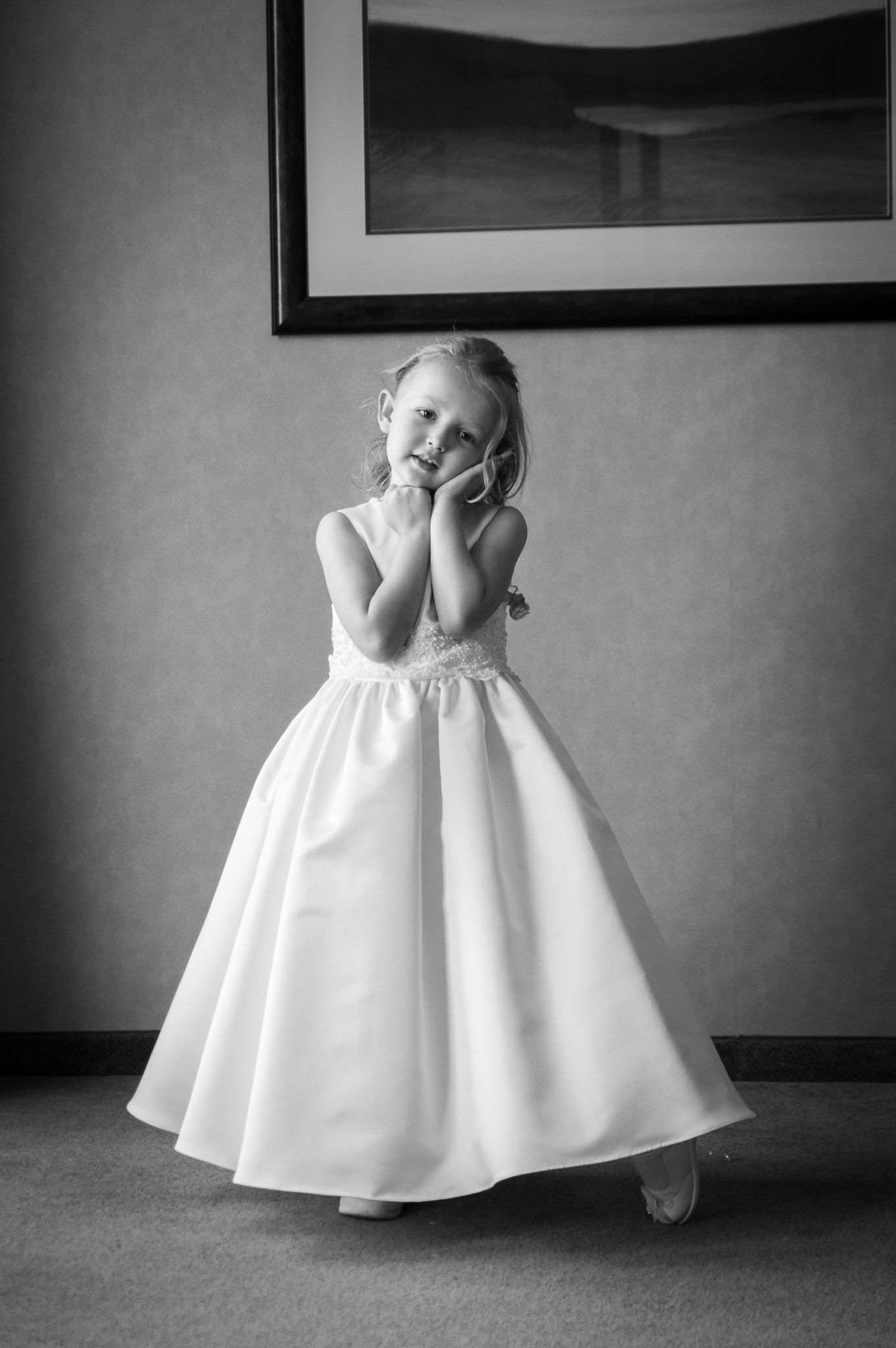 Flower girl looking at camera in black and white