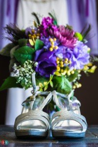 Wedding details - high heels in front of flowers and purple dresses in Coquitlam