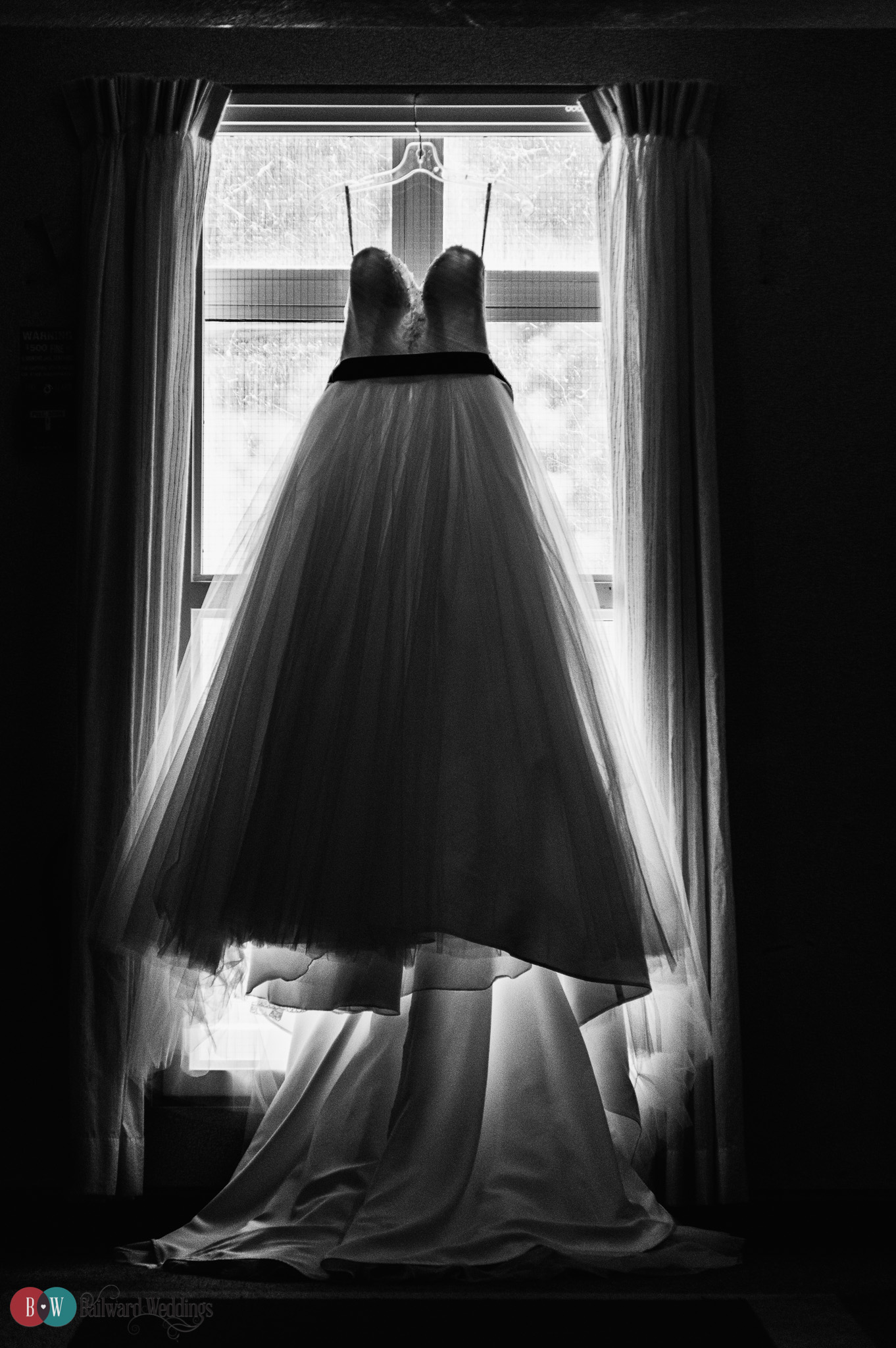 Wedding dress in front of window in Harrison Hot Springs in Black and White