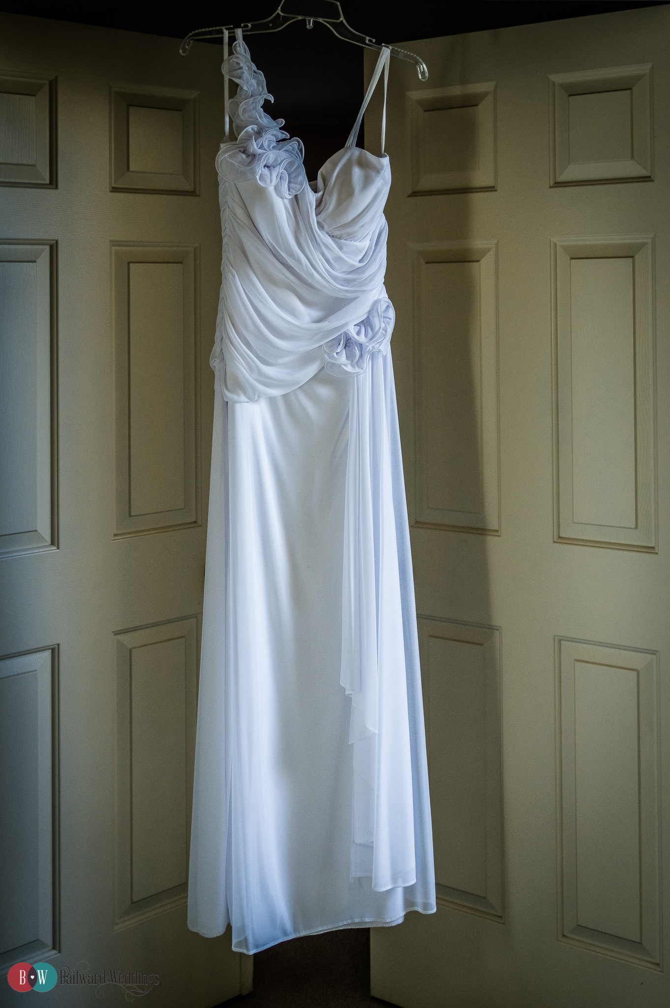 Wedding dress hanging in doorway in Port Moody BC