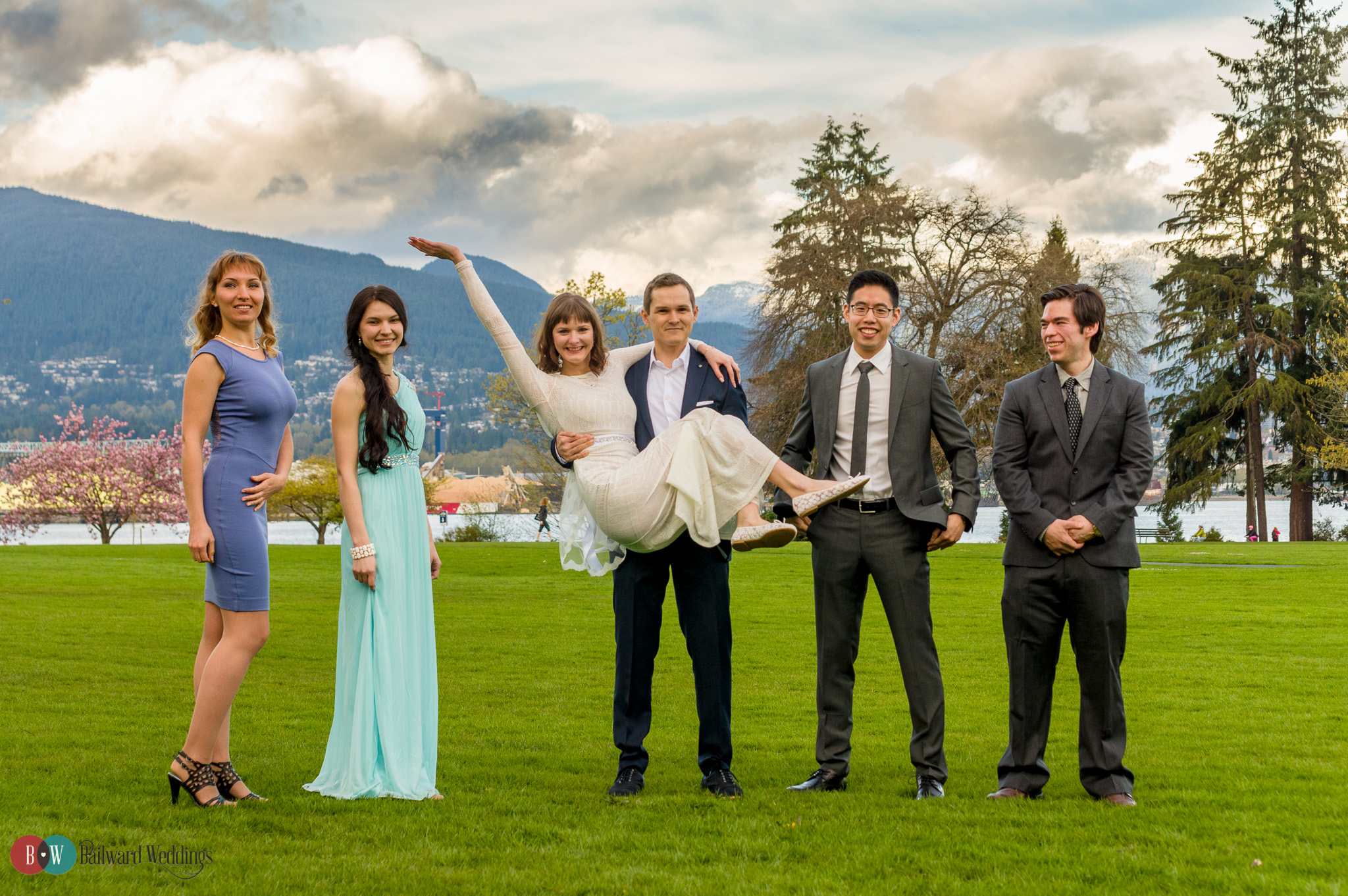 Wedding party with goofy bride and groom in Stanley Park