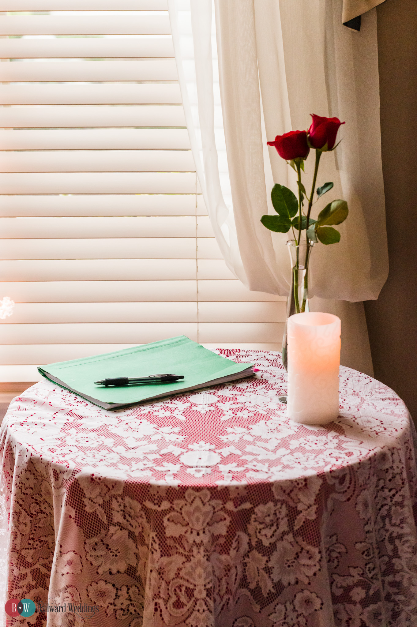 Rose on marriage paperwork signing table