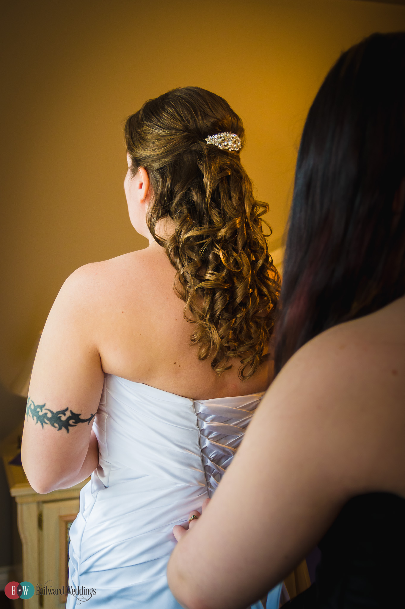 Bride getting ready from behind