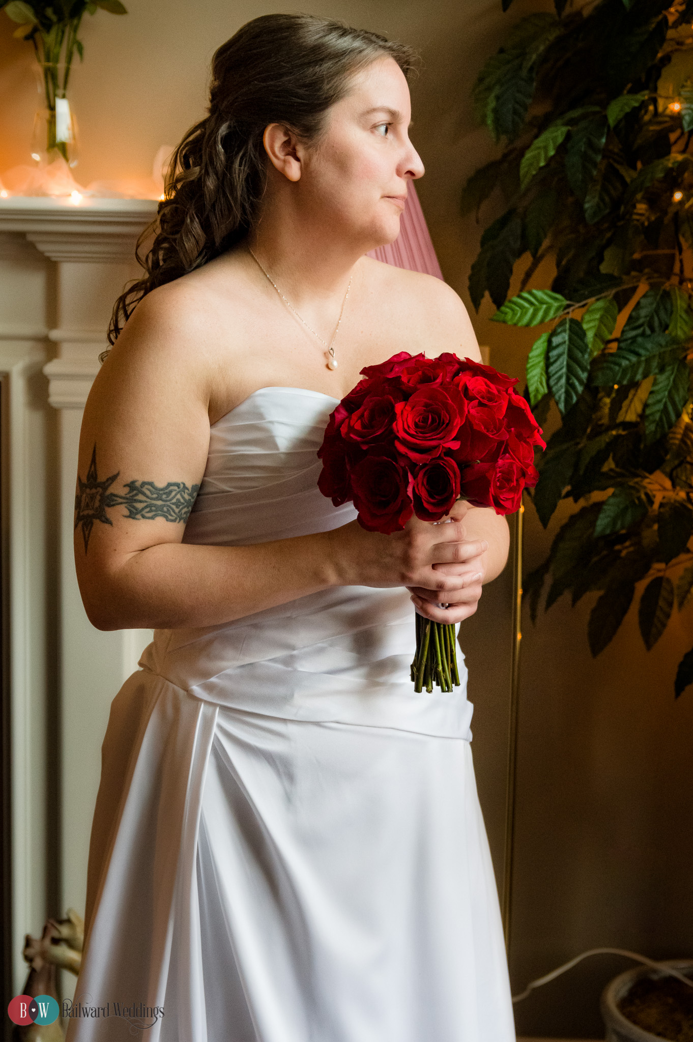 Bride in ceremony with red flowers