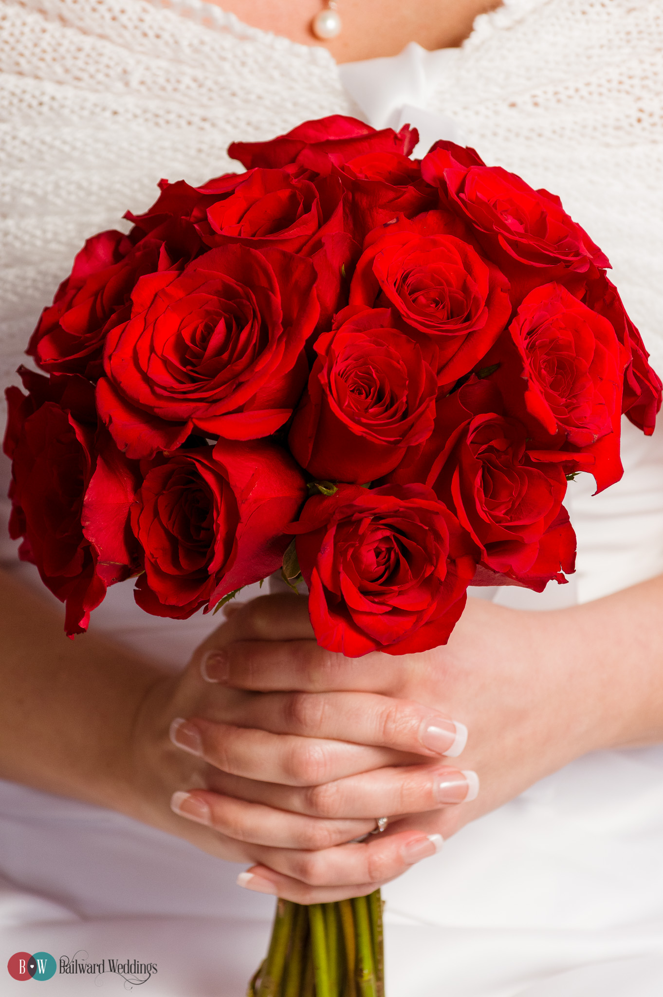 Bride holding red roses