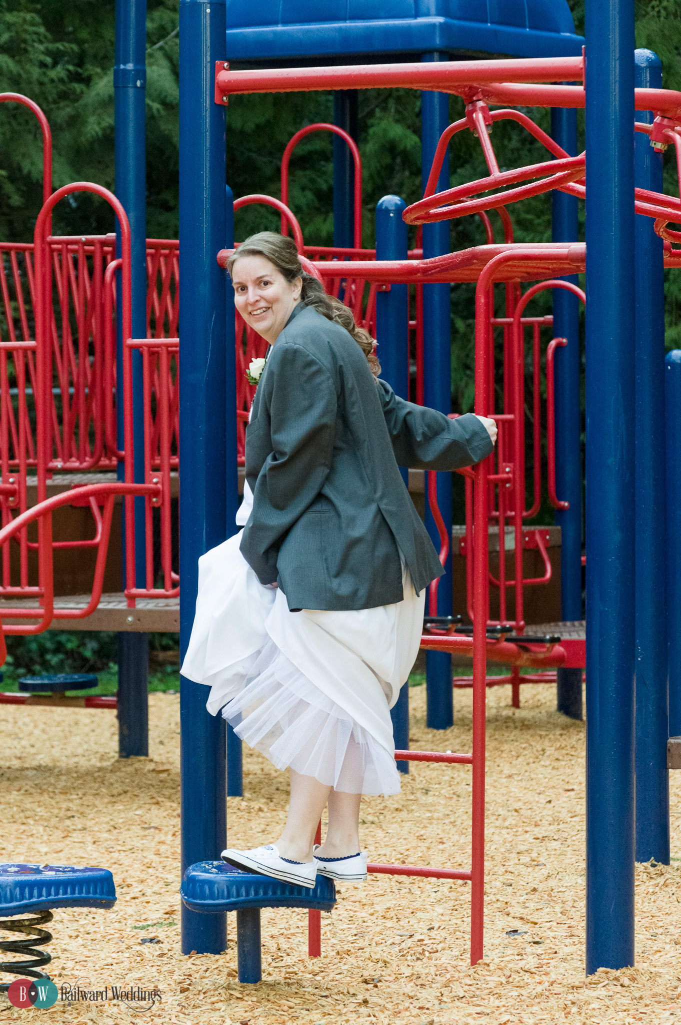 Bride playing on playground