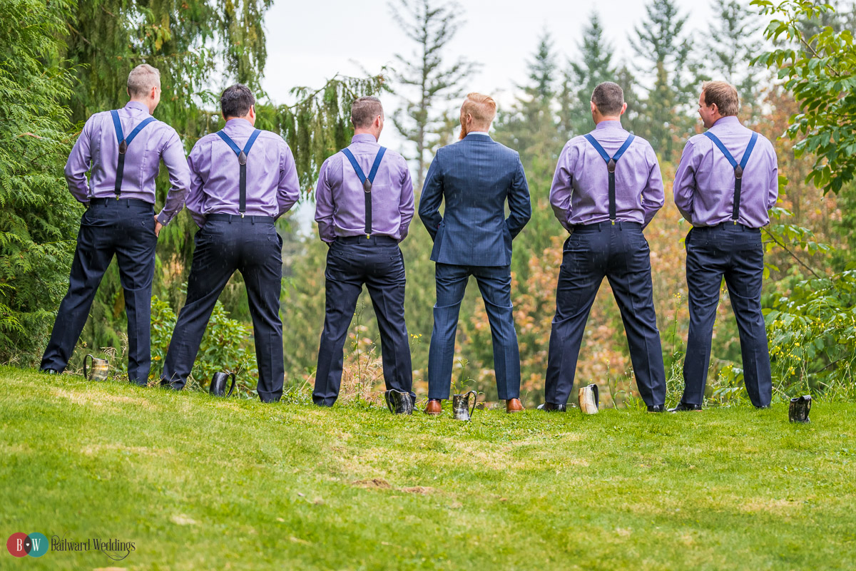Groomsmen and groom taking a quick break